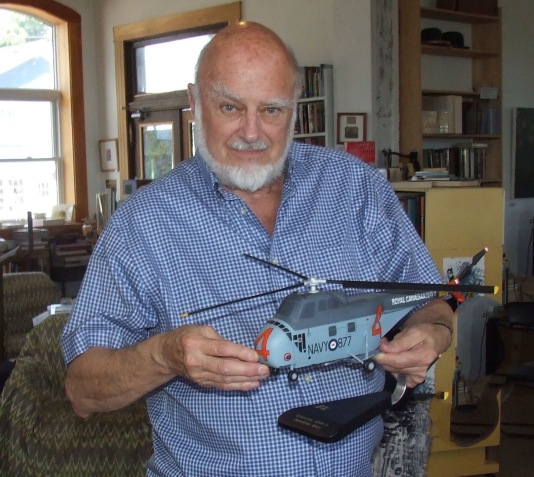 Colin Curleigh with the Navy helicopter he flew during the Cuban missile crisis