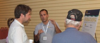 Manager Jeremy Poste (centre) explains tidal project at open house last fall