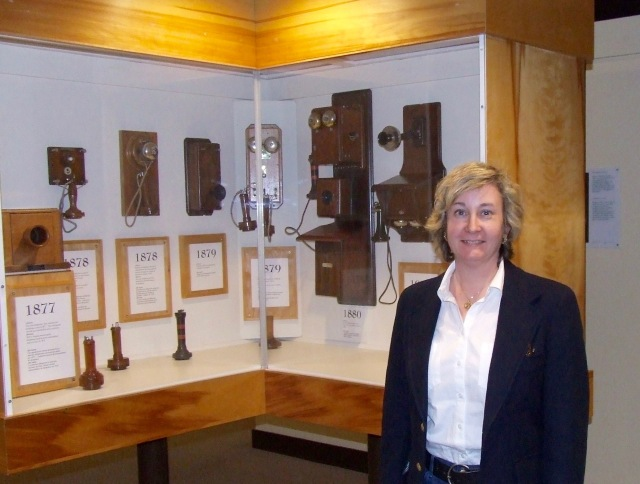 Valerie Mason with display of early telephones