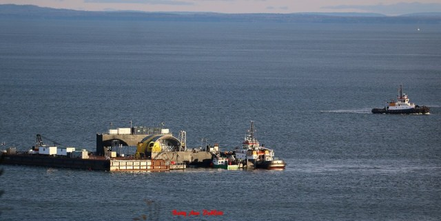 Scotia Tide barge HFX (carrying the OpenHydro turbine), and Atlantic Hemlock tug in Pleasant Cove, off Cape Sharp. Photo taken by Betty Ann DeWitt on Saturday